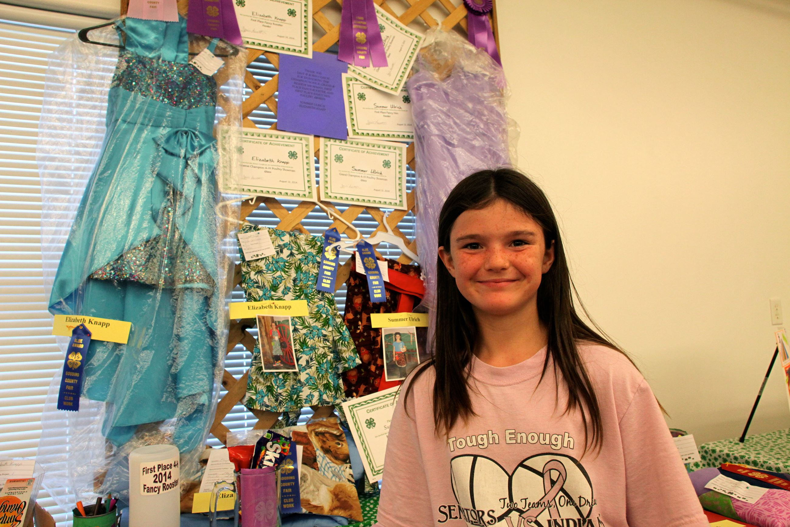 A 4-H member with her project display